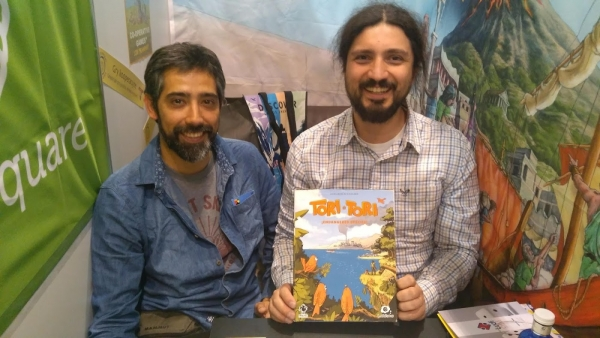 Hugo (left) and Pablo (right) showing one of their own titles in our Booth at Spiel.